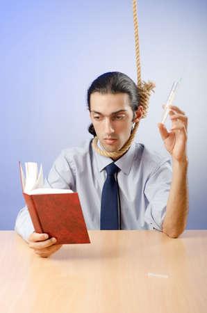 Man reading bible and taking drugs photo