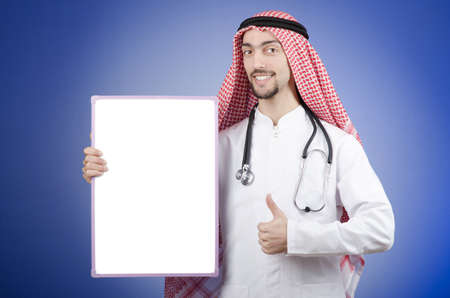 Arab with blank board photo