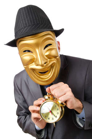 Masked man with clock on white Stock Photo - 12580841