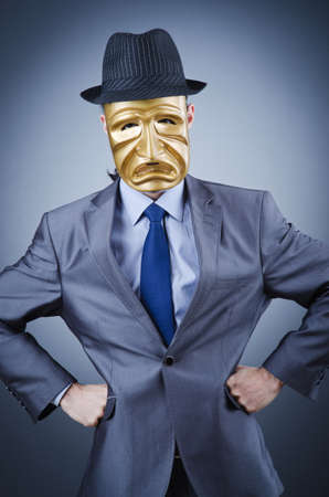 Businessman with mask concealing his identity Stock Photo - 12580657
