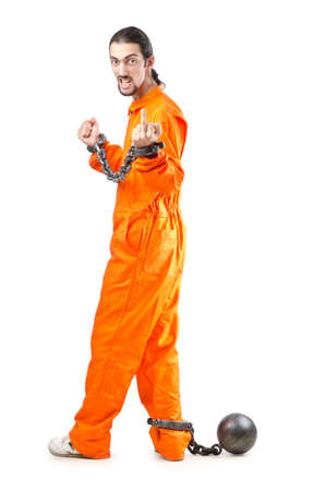 Criminal in orange robe in prison Stock Photo - 12580542