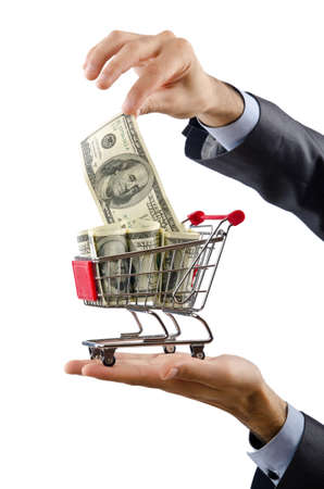 grocery store checkout: Shopping cart full of money Stock Photo