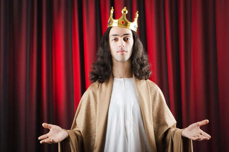 Funny king against red curtain photo