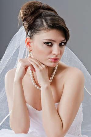 Bride in wedding dress in studio shooting photo