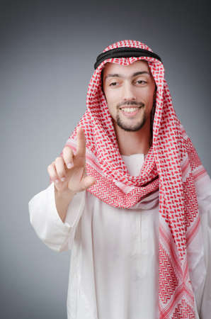 Arab pushing virtual buttons photo