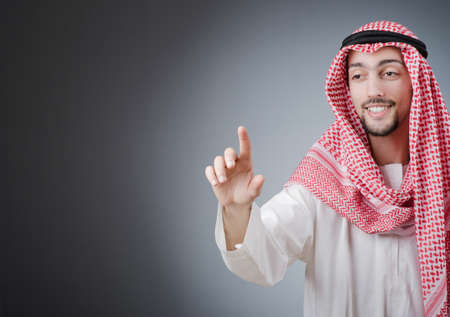 arabic man: Arab pushing virtual buttons Stock Photo