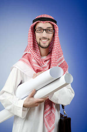 Arab engineer with drawings photo