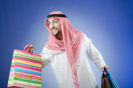 Arab with the gift bags photo