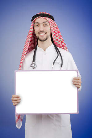Arab with blank board photo