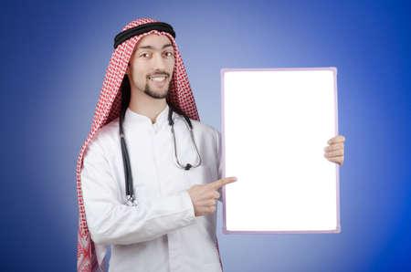 Arab with blank board Stock Photo - 13305956