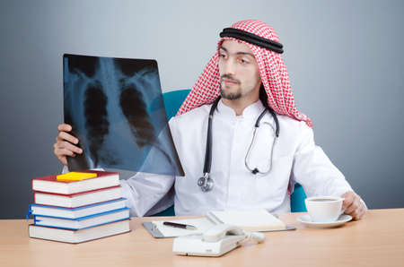 Arab doctor with x-ray print photo