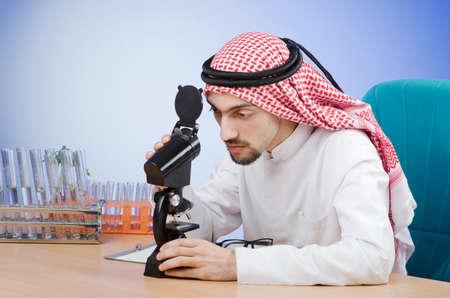 Arab chemist working in lab Stock Photo - 12740271