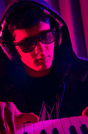 DJ mixing music at disco photo