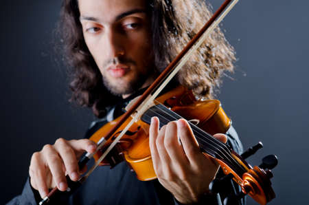 Violin player playing the intstrument Stock Photo - 12740202