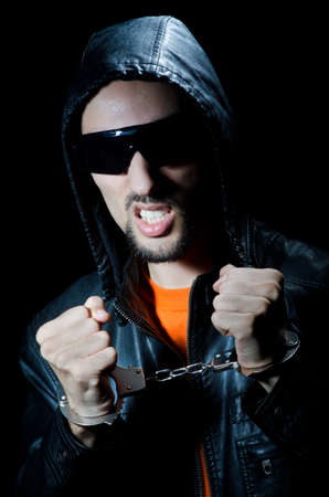 Young criminal with handcuffs Stock Photo - 12740321