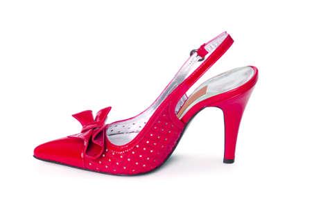 tacones rojos: Zapatos femeninos en el fondo blanco