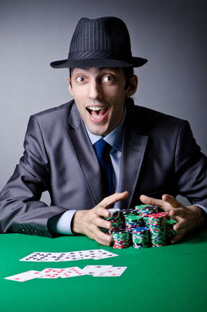 Casino player playing with chips photo