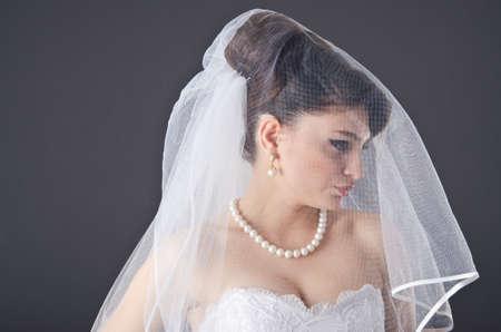 Bride in wedding dress in studio shooting Stock Photo - 12873386