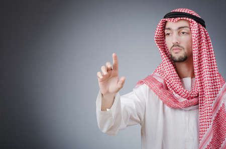 Arab pushing virtual buttons Stock Photo - 12873480