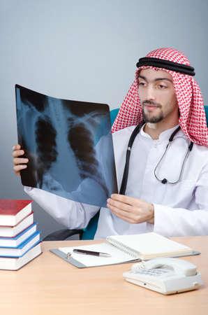 Arab doctor with x-ray print photo