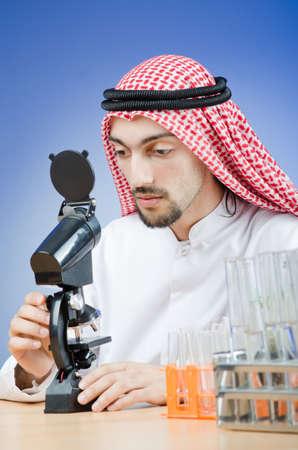Arab chemist working in lab Stock Photo - 12873585