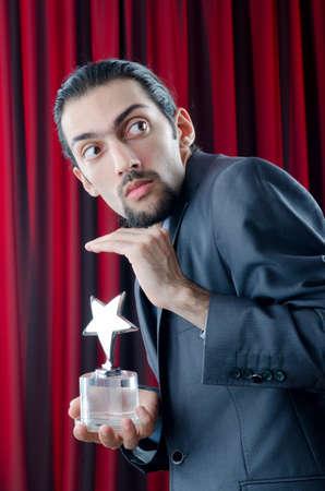 Businessman awarded with star award Stock Photo - 12873431