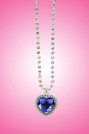 diamond jewellery: Silver pendant against gradient background