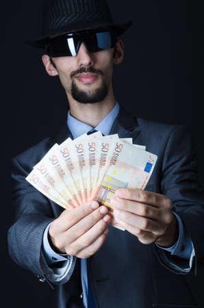 Man with counterfeir money photo