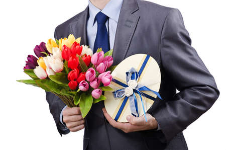 Businessman with giftbox and flowers Stock Photo - 13019292