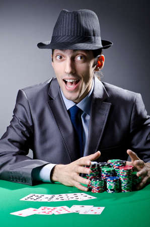 Casino player playing with chips Stock Photo - 13063328