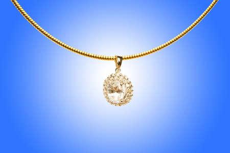 Golden jewellery against gradient background Stock Photo - 13014967