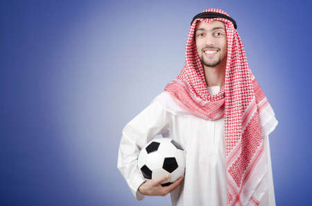 Arab with football in studio shooting photo