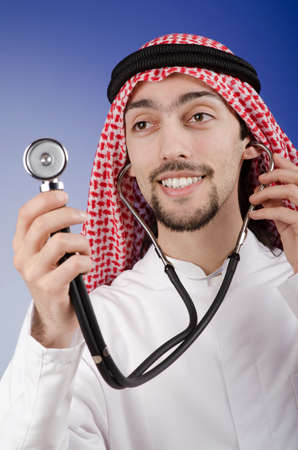 Arab doctor in studio shooting photo