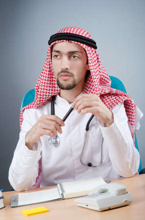 Arab doctor working in hospital photo