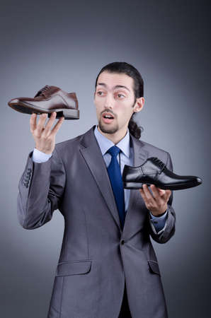 Man with a selection of shoes Stock Photo - 13063319