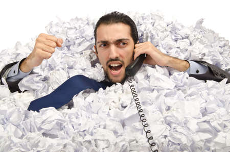 Man with lots of crumpled paper photo