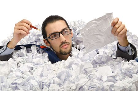 Man with lots of waste paper Stock Photo - 13063227