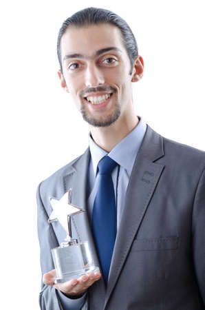 Businessman with award on white photo