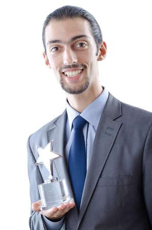 Businessman with award on white photo