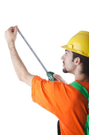 Worker with measuring tape on white photo