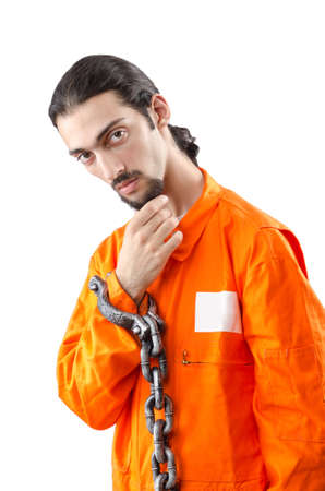 Criminal in orange robe in prison photo