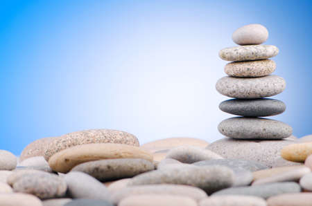 Pebbles stack against gradient background Stock Photo - 13012854