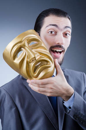concealing: Businessman with mask concealing his identity