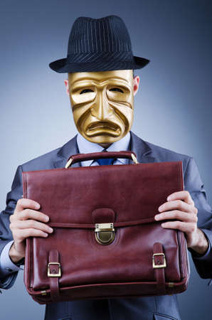 Businessman with mask concealing his identity Stock Photo - 13018460