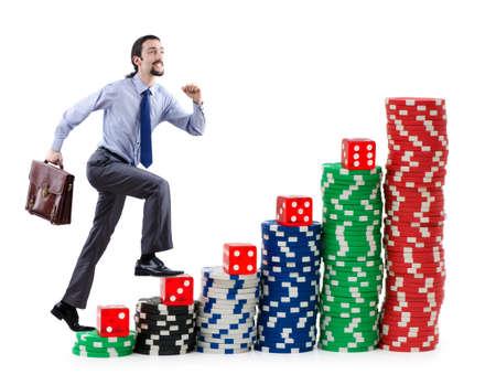 Businessman climbing stacks of casino chips photo