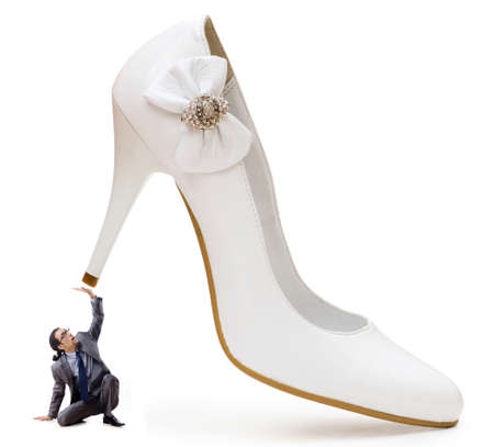 dominating: Woman domination concept with shoes and man Stock Photo