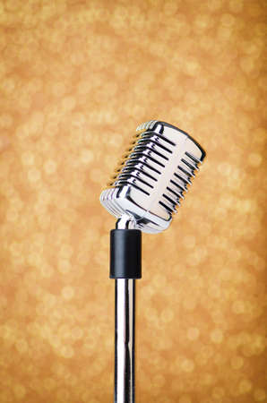 Old vintage microphone on background photo