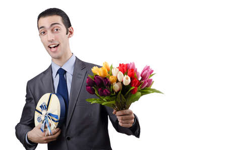 Businessman with giftbox and flowers photo