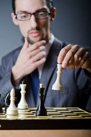Chess player playing his game photo