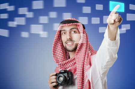 Young arab pressing virtual buttons Stock Photo - 13261386
